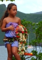 Marquesan girl with flowers