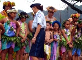 Marquesan children and French police officer