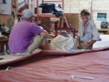 fixing-the-mainsail-at-snug-harbour-sails